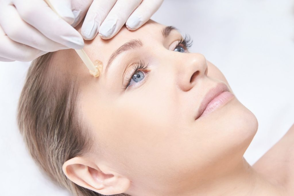 Brow waxing of a woman